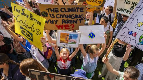SYDNEY, AUSTRALIA - SEPTEMBER 20: Thousands of school students and protesters gather in The Domain ahead of a climate strike rally on September 20, 2019 in Sydney, Australia. Rallies held across Australia are part of a global mass day of action demanding action on the climate crisis.  (Photo by Jenny Evans/Getty Images)