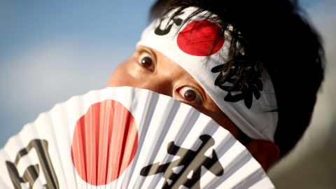 CHOFU, JAPAN - SEPTEMBER 20: A Japan fan poses for a photo outside the stadium prior to the Rugby World Cup 2019 Group A game between Japan and Russia at the Tokyo Stadium on September 20, 2019 in Chofu, Tokyo, Japan. (Photo by Cameron Spencer/Getty Images)