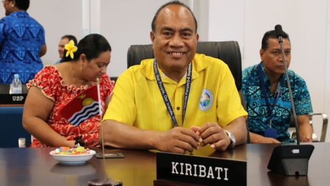 """Kiribati President Taneti Mamau (C) smiles as he attends the """"Small Islands States"""" meeting at the Civic Center in Aiwo on the Pacific island of Nauru on September 3, 2018."""