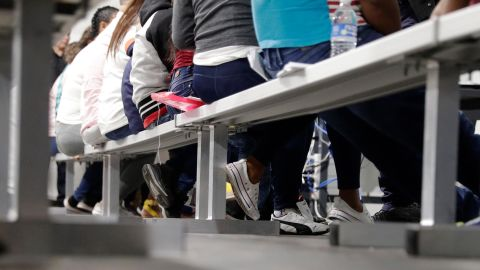 Migrants who are applying for asylum in the United States go through a processing area at a new tent courtroom at the Migration Protection Protocols Immigration Hearing Facility, Tuesday, September 17, 2019, in Laredo, Texas.