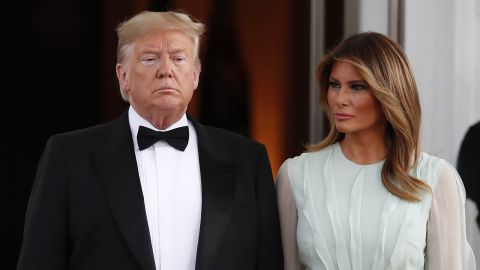 President Donald Trump and first lady Melania Trump wait to welcome Australian Prime Minister Scott Morrison and his wife, Jennifer Morrison, as they arrive for a state dinner at the White House, Friday, Sept. 20, 2019, in Washington.
