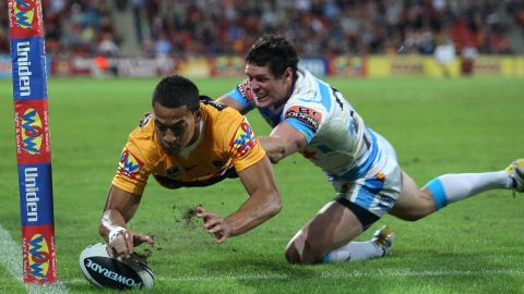 Folau of the Broncos scores a try in the NRL.