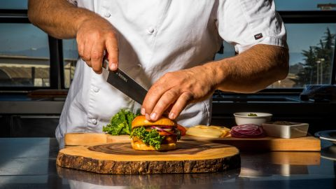 """Moss Landing, CA - September 5, 2019: Chef Tucker Bunch prepares Sweet Earth's """"Awesome Burger"""" in the test Kitchen at their Moss Landing headquarters."""