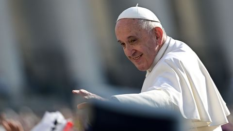 Pope Francis waves to pilgrims upon his arrival at Saint Peter's square in Vatican, to lead his weekly general audience on September 18, 2019.