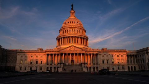 The rising sun divides the West Front of the U.S. Capitol in Washington, September 25.