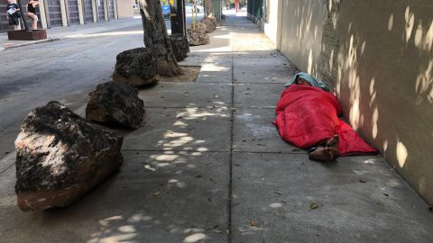 Neighbors organized efforts to use boulders to stop the homeless from pitching tents on their sidewalks.
