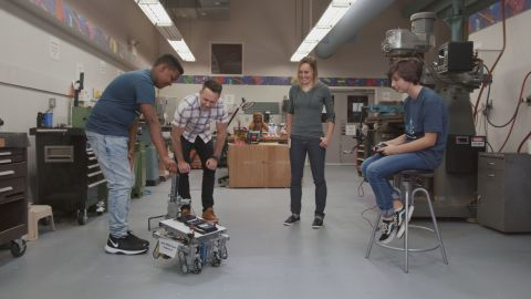 FIRST students demonstrate the capabilities of their robots.