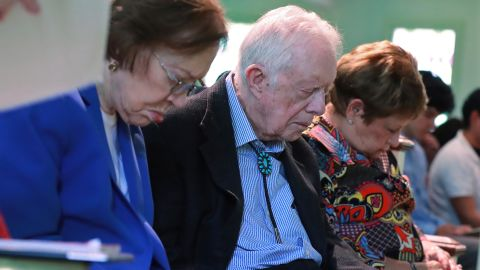 Jimmy and Rosalynn Carter bow their heads in prayer at a church in Plains, Georgia, in June 2019. It was less than a month after the former president fell and broke his hip.