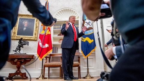 President Donald Trump speaks to member of the media as he departs a ceremonial swearing in ceremony for new Labor Secretary Eugene Scalia in the Oval Office of the White House in Washington, Monday, September 30, 2019.