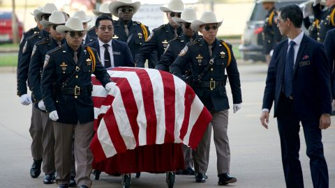 An honor guard escorts Dhaliwal's casket into his funeral service on Wednesday.