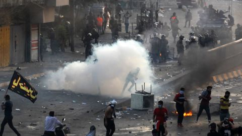 """Iraqi police fire teargas at protesters during a demonstration against state corruption, failing public services and unemployment at Tayaran square in Baghdad on October 2, 2019. - Iraq's president and the United Nations urged security forces to show restraint after two protesters were killed in clashes with police that other top officials blamed on """"infiltrators."""" (Photo by AHMAD AL-RUBAYE / AFP) (Photo by AHMAD AL-RUBAYE/AFP via Getty Images)"""
