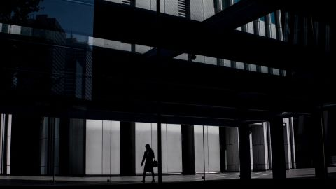 A woman leaves an office building in Tokyo, Japan (file photo).