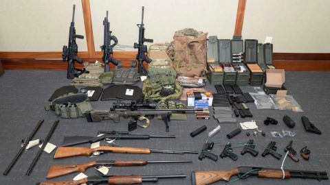 This file image provided by the Maryland US District Attorney's Office shows a photo of firearms and ammunition that was in the motion for detention pending trial in the case against Christopher Paul Hasson.