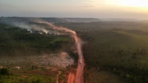 Red road dust mixes with fire smoke in the town of Ruropolis, Para State, Brazil, on September 6, 2019.