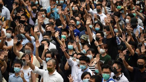 Pro-democracy demonstrators hold up their hands to symbolise their five demands during a protest against an expected government ban on protesters wearing face masks at Chater Garden in Hong Kong on October 4, 2019. - Hong Kong's government was expected to meet October 4 to discuss using a colonial-era emergency law to ban pro-democracy protesters from wearing face masks, in a move opponents said would be a turning point that tips the financial hub into authoritarianism. (Photo by Mohd RASFAN / AFP) (Photo by MOHD RASFAN/AFP via Getty Images)