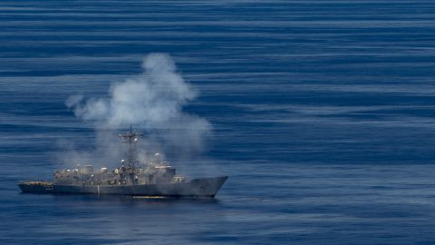 The former USS Ford, a decommissioned frigate, sustains damage as U.S. Navy ships, aircraft and a submarine and Republic of Singapore ships fire at it during a sinking exercise off Guam on Tuesday.
