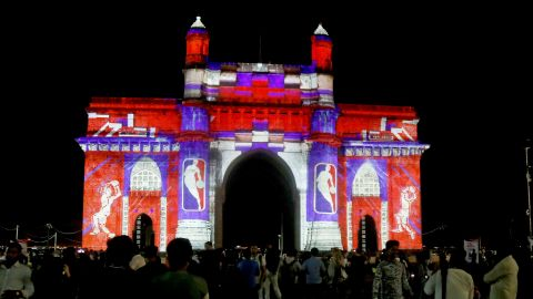The Gateway of India monument is lit up with graphics and the logo of the NBA in Mumbai on September 28, 2019.