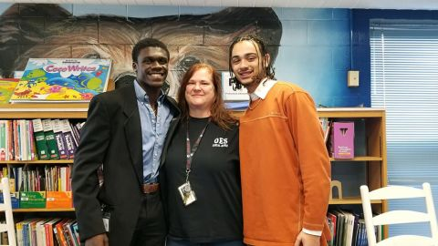 Kyle Fersner (on the right) with his fellow teaching cadet and their former fifth grade teacher.
