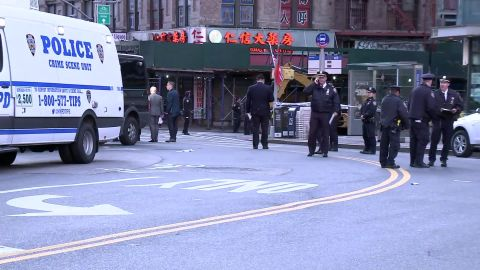 Police gathered in Manhattan's Chinatown neighborhood on Saturday morning after attacks on five men in the borough who were believed to be homeless.