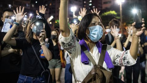 People protest the ban against masks on Saturday, October 5.