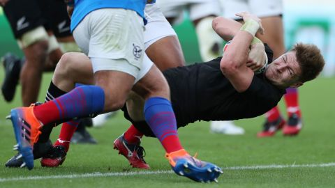 Jordie Barrett of New Zealand dives to score his side's tenth try a 71-9 win for the All Blacks over Namibia in Pool B at the Tokyo Stadium.