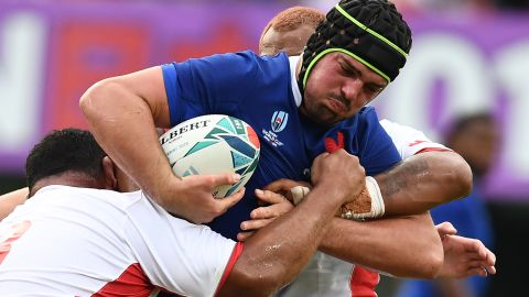 France's number 8 Gregory Alldritt, right, is tackled by Tonga's prop Ma'afu Fia.