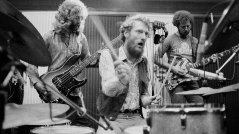 English rock group the Baker Gurvitz Army in a studio, August 1974. Left to right: Paul Gurvitz, Ginger Baker and Adrian Gurvitz. (Photo by Michael Putland/Getty Images)
