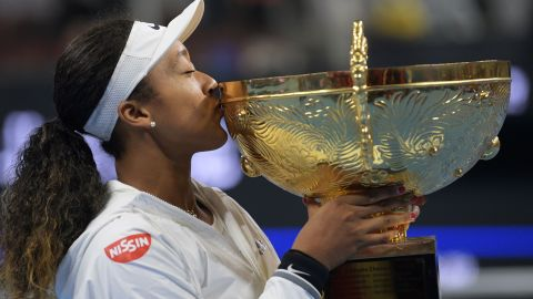 Naomi Osaka of Japan poses with the trophy after beating Australia's Ashleigh Barty in the final of the China Open in Beijing.