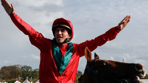 French jockey Pierre-Charles Boudot celebrates his victory on Waldgeist in the 2019 Qatar Prix de l'Arc de Triomphe.
