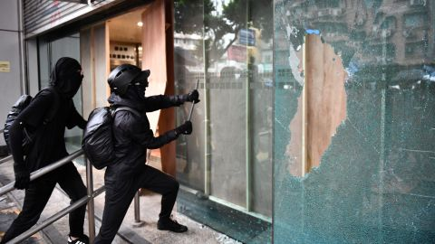 Protesters vandalize the Cheung Sha Wan local government offices in Hong Kong on Sunday.