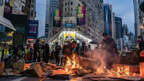 Pro-democracy protesters set fires in the street in the Causeway Bay area.