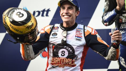 Spain's Marc Marquez celebrates on the podium after winning the Thailand MotoGP to clinch his sixth world title in the premier class and eighth overall.