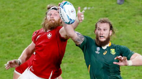 Canada's Evan Olmstead (left) and South Africa's RG Snyman compete for the ball.