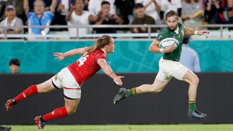 South Africa's Cobus Reinach runs clear of Canada's Jeff Hassler during the Pool B game at Kobe Misaki Stadium.