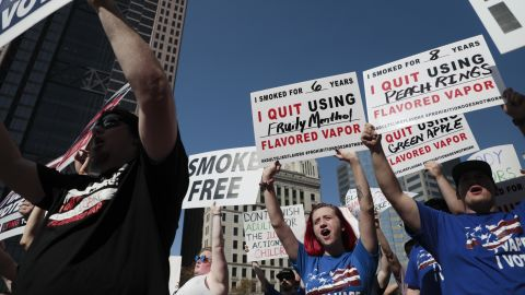 """Vaping advocates chant """"I Vape, I Vote"""" during a rally on Tuesday, Oct. 1, 2019 at the Ohio Statehouse in Columbus, Ohio. The Ohio Vapor Trade Association and the Vapor Technology Association hosted the rally. (Joshua A. Bickel/The Columbus Dispatch via AP)"""