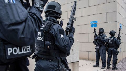 CORRECTS CITY TO DRESDEN -- Police officers secure a synagogue in Dresden, Germany, Wednesday, Oct. 9, 2019. One or more gunmen fired several shots on Wednesday in the German city of Halle. Police say a person has been arrested after a shooting that left two people dead. (Robert Michael/dpa via AP)