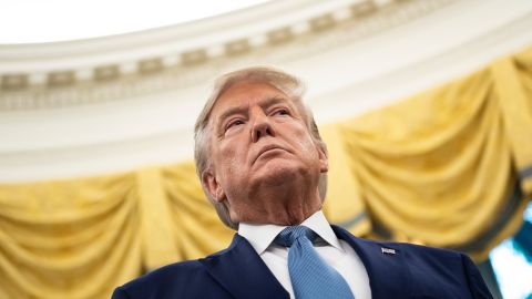 US President Donald Trump listens during a Presidential Medal of Freedom ceremony for Edwin Meese in the Oval Office at the White House in Washington, DC on October 8.