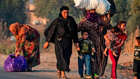 Refugees leave their homes near the Turkey-Syria border.