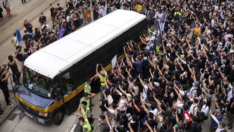 """Supporters surround a police bus carrying political activist Edward Leung as it leaves the High Court in Hong Kong on Wednesday, October 9. Several hundred masked protesters gathered at Hong Kong's High Court for the appeal hearing of Leung, <a href=""""https://www.cnn.com/2018/06/11/asia/edward-leung-hong-kong-jailed-intl/index.html"""" target=""""_blank"""">who was sentenced to six years in prison</a> for his part in a violent clash with police."""