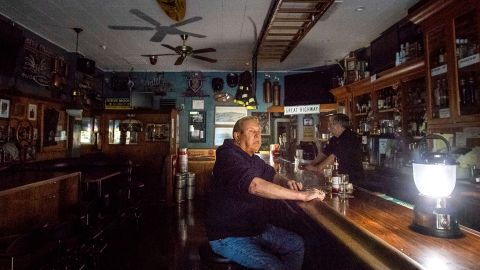 Joseph Pokorski drinks a beer at a bar on Wednesday in Sonoma, California, as the city faces a power outage.
