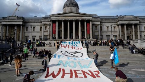 Climate activists protest on the steps of the National Gallery in Trafalgar Square.