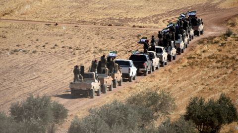 Turkish-backed fighters of the Free Syrian Army head toward Tal Abyad, Syria, on Thursday, October 10.