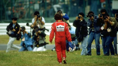 Alain Prost walks away from the scene of his collision with Ayrton Senna in 1989.
