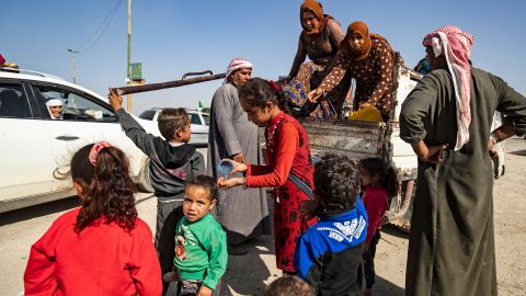 Refugees arrive in Tal Tamr, Syria, after fleeing the fighting on October 10.