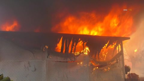 The fire has burned multiple buildings in the Villa Calimesa Mobile Home Park.