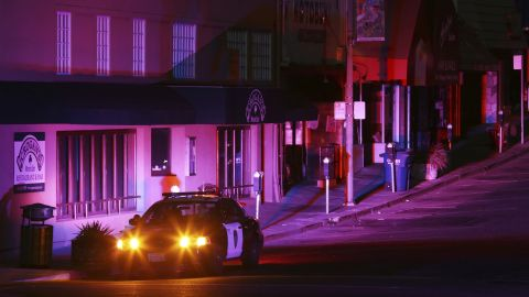 Oakland police officers patrol a street in the Montclair shopping district during a power outage.