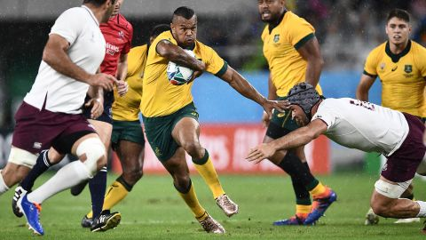 Australia's full back Kurtley Beale (C) runs with the ball during the match between Australia and Georgia.
