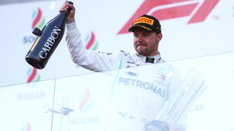 Bottas celebrates on the podium after winning the Azerbaijan Grand Prix.