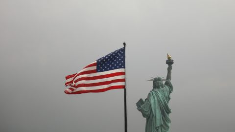 An America flag flies near the Statue of Liberty on Liberty Island on August 14, 2019 in New York City.