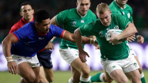 Ireland's Keith Earls runs past the Samoan defense during the Rugby World Cup Pool A game at Fukuoka Hakatanomori Stadium between Ireland and Samoa, in Fukuoka on Saturday.